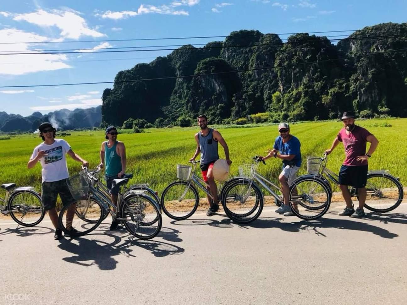 group of tourists cycling around hoa lu